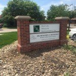Custom outdoor brick business sign for SBS Private Wealth Management, Inc.