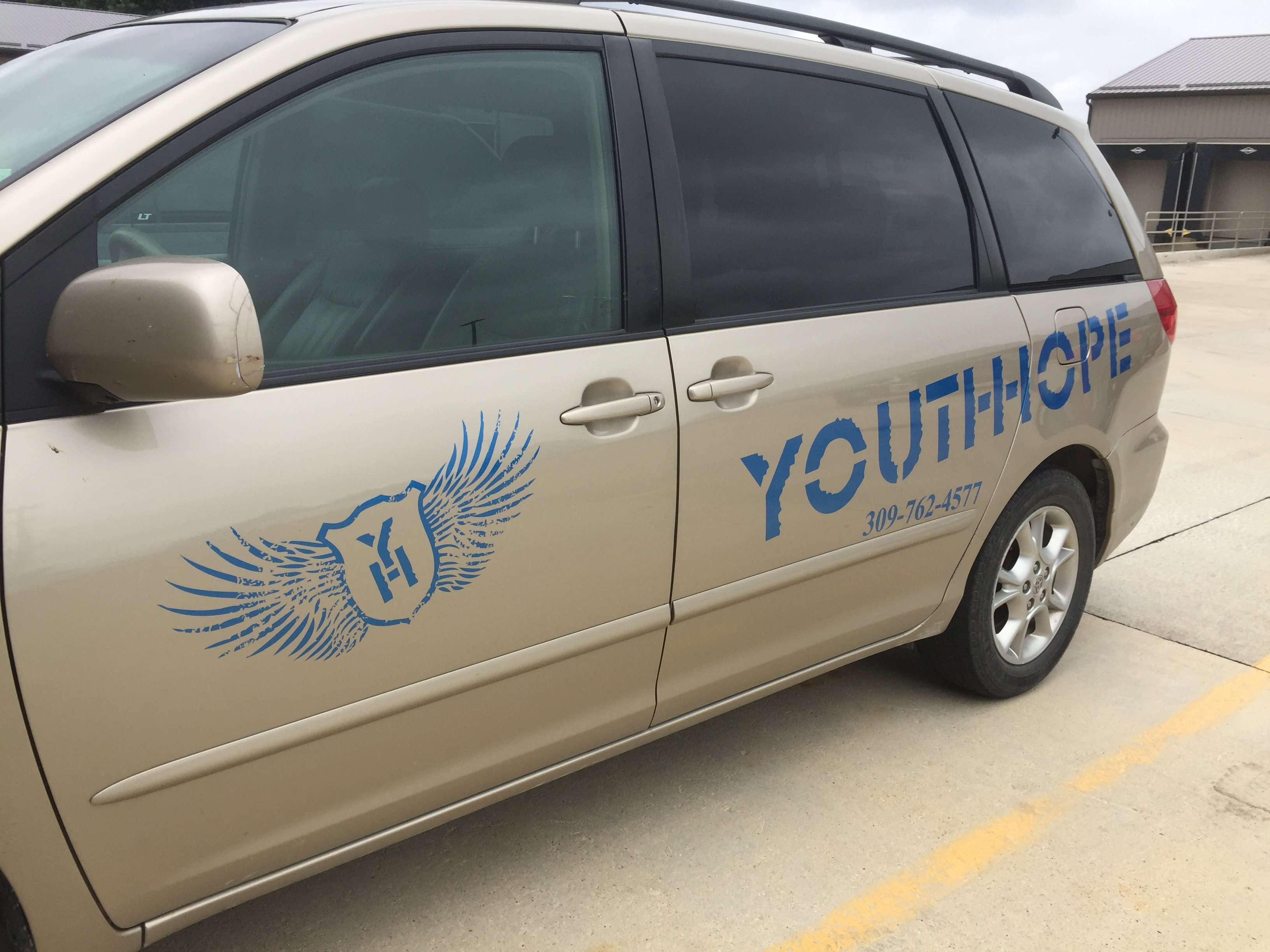 Vehicle Graphics and Lettering for YouthHope in Moline, Illinois