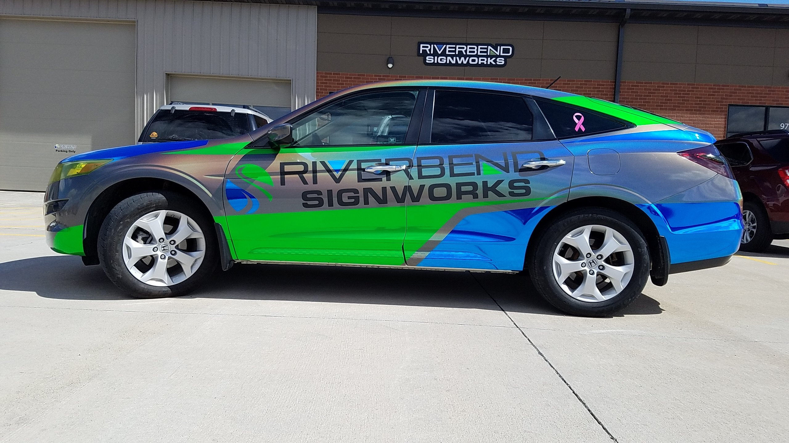 Iridescent car wrap for Riverbend Signworks in Iowa and Illinois